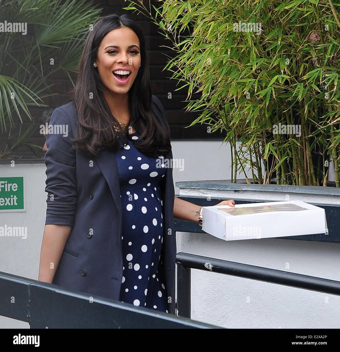 f2528d4754047 Pregnant birthday girl Rochelle Humes of The Saturdays leaves the ITV  studios in a blue polka dot dress Featuring: Rochelle Humes Where: London,  ...