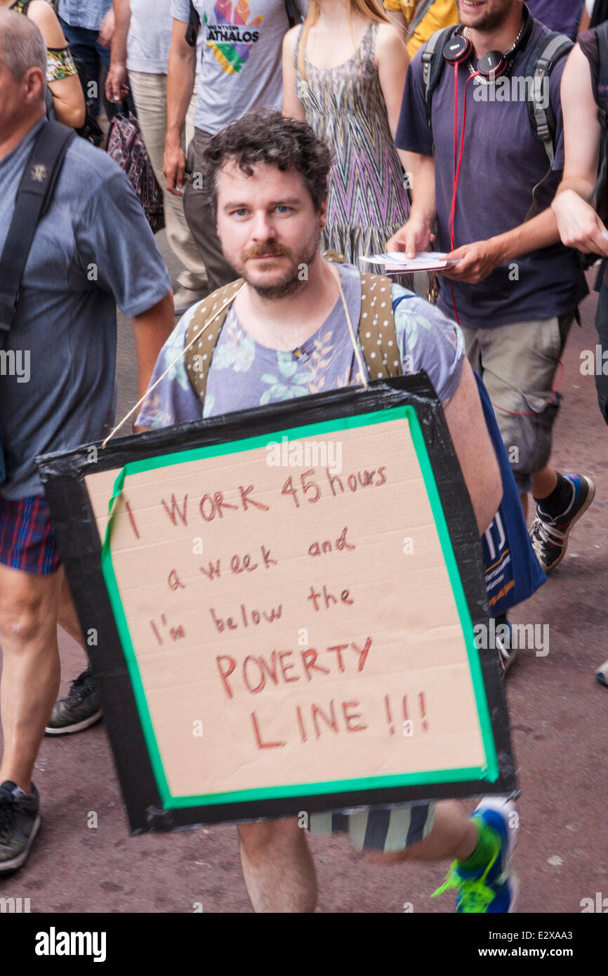 London, June 21st 2014. Many anti-cuts protesters also carried placards highlighting the need for a living wage. - Stock Image