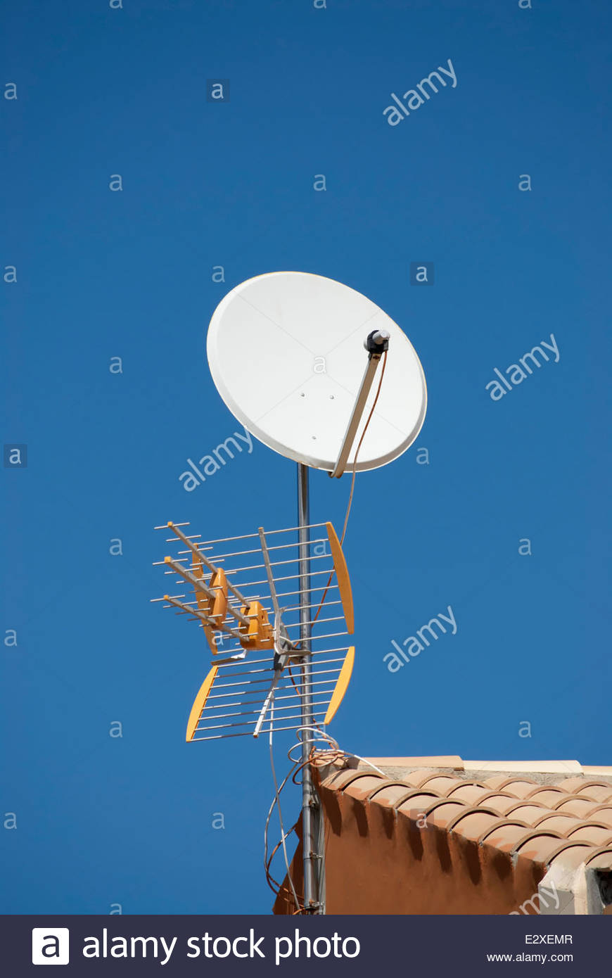 TV aerial and satellite dish fixed to the roof Stock Photo
