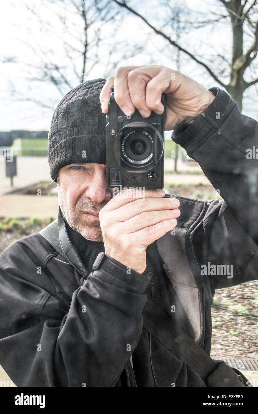 Photographer at work with Fujifilm x-pro1 - Stock Image
