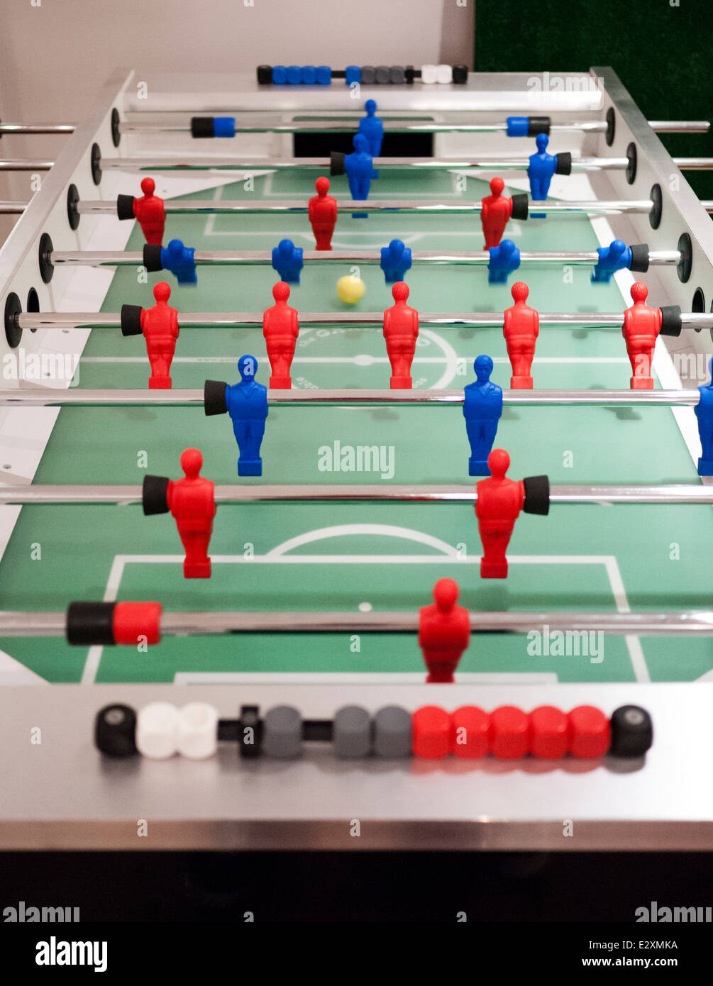 A game of fussball (table football) being played. Reds verses blues. - Stock Image