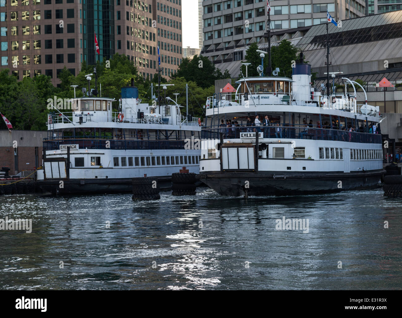 Two ferry boats wait to take passengers to the Toronto Islands a chain of small islands a short ride from the downtown Stock Photo