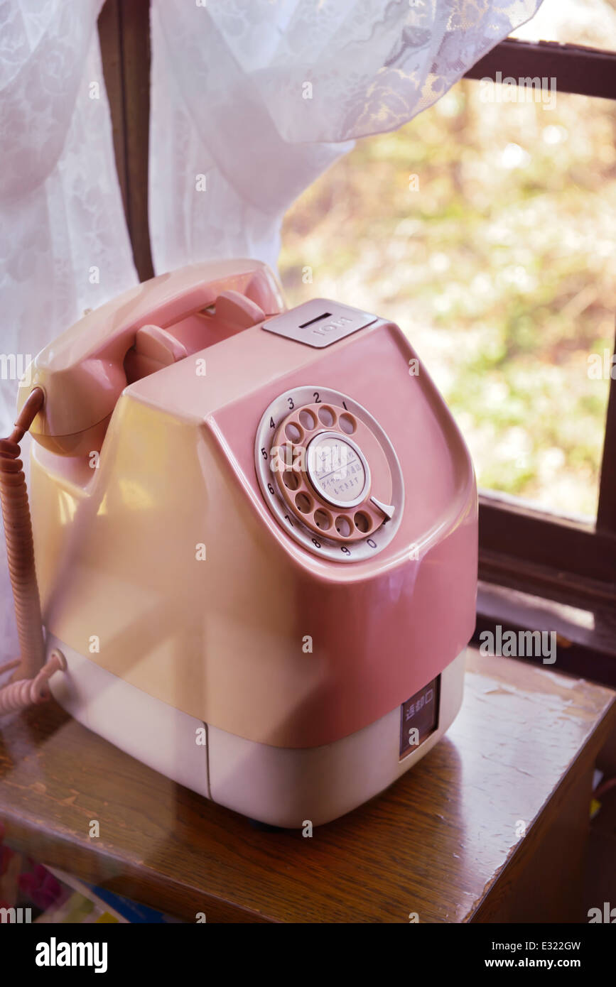 Cute pink vintage telephone at a booth in Japan - Stock Image