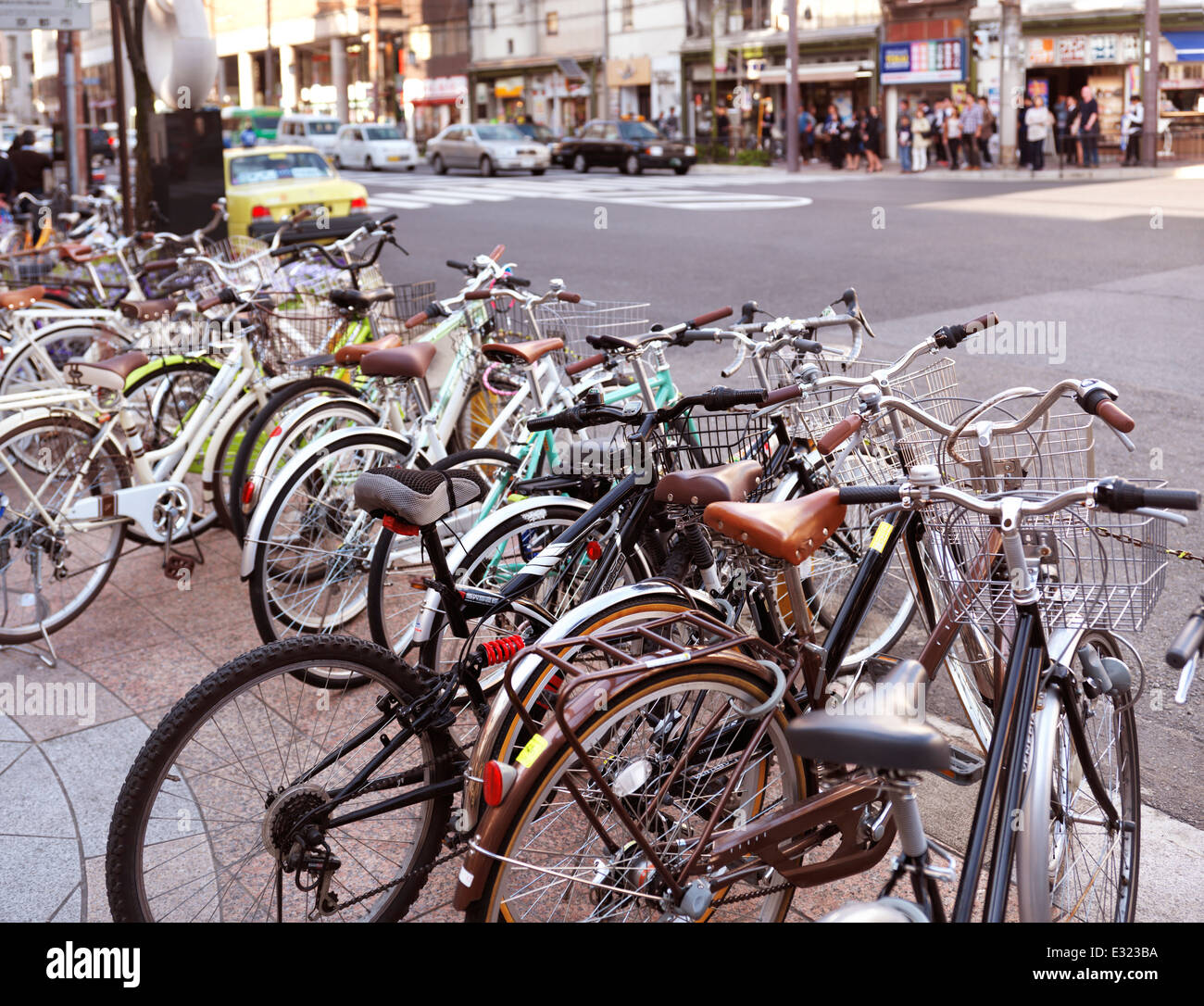 Bicycles parked on streets of Kyoto Japan 2014 - Stock Image