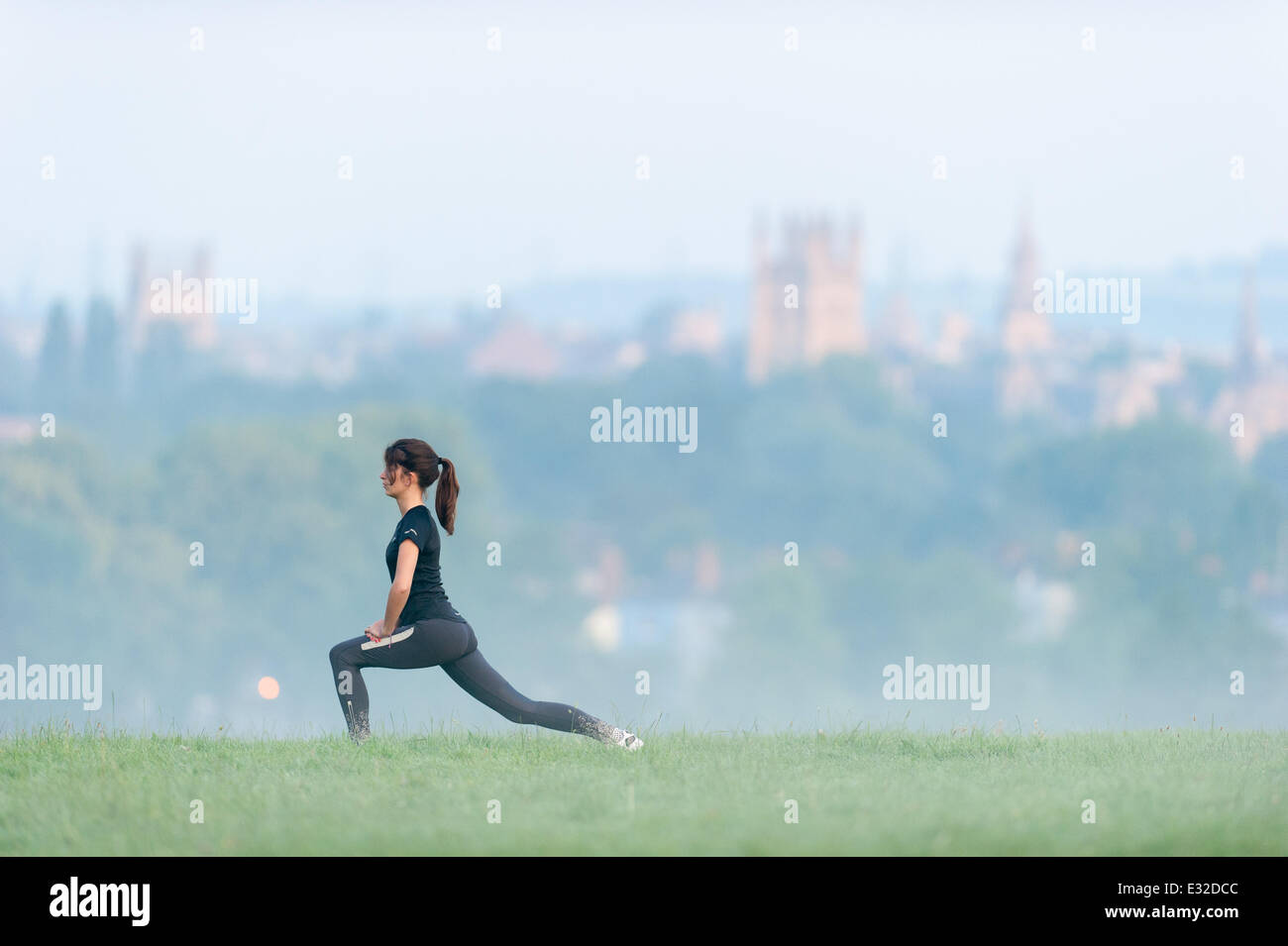A girl jogging on a misty morning in South Park, Oxford, UK - Stock Image