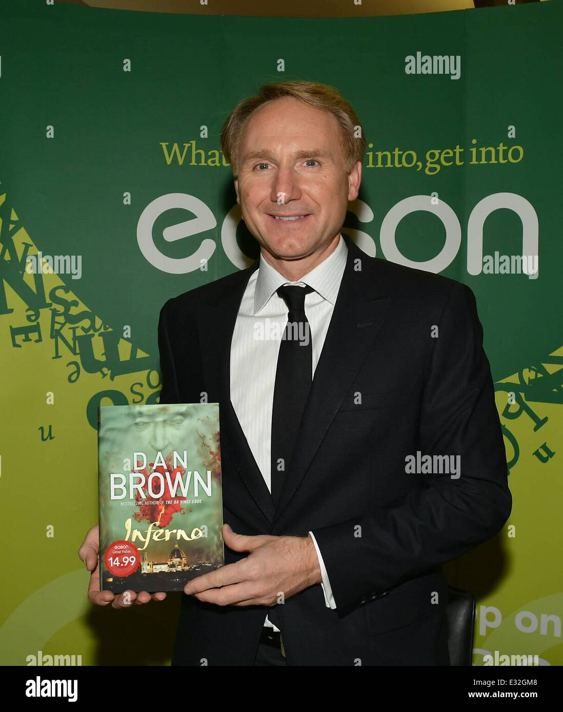 Author of the Da Vinci Code, Dan Brown is presented with a copy of the Book of Kells by Easons MD Conor Whelan at - Stock Image