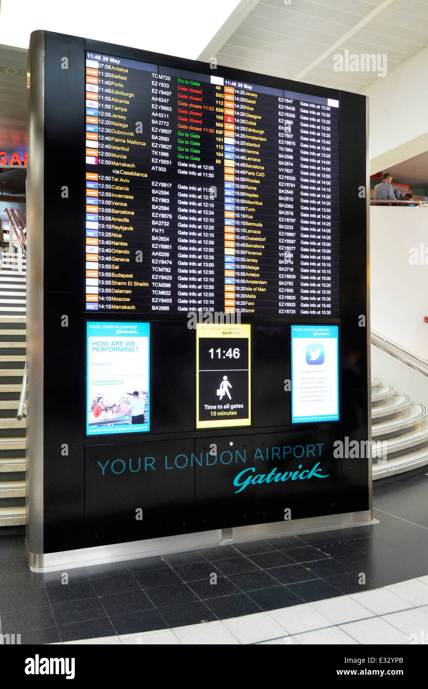 Airport Departures Board at London Gatwick Airport North Terminal departure lounge Crawley West Sussex - Stock Image