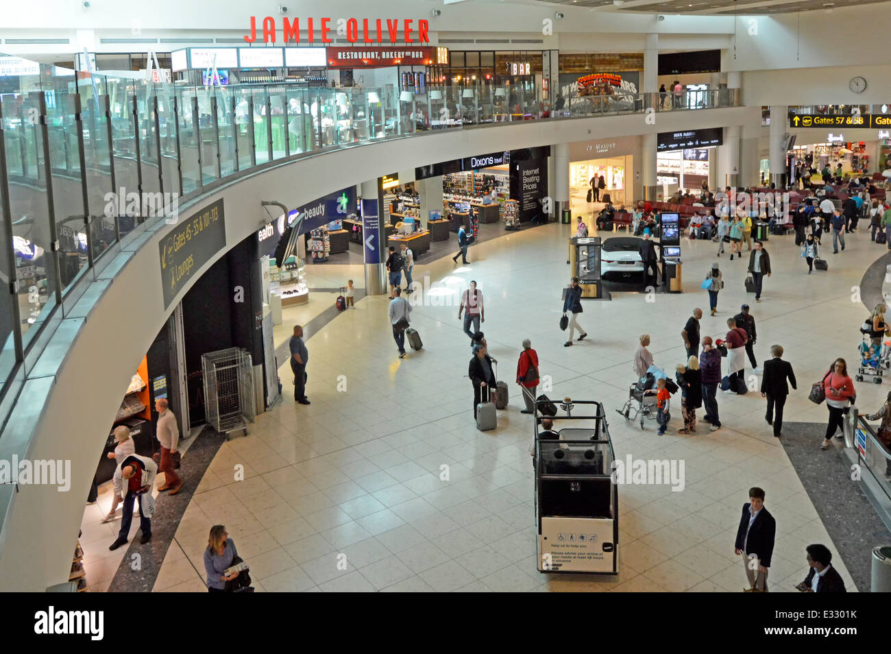 Jamie Oliver restaurant above the Gatwick Airport North Terminal departure lounge and shopping concourse Crawley - Stock Image