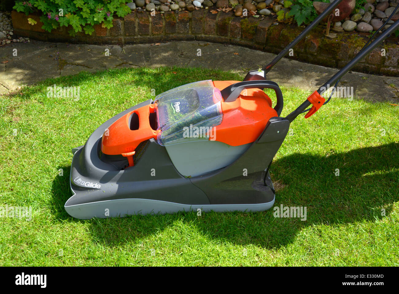 New Flymo Ultra Glide lawn mower on domestic back garden grass lawn Essex England UK - Stock Image