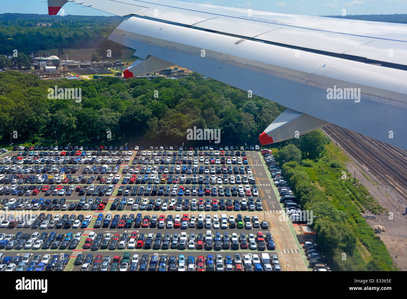 Aerial view of car park airport car parking seen from passenger jet decending towards Gatwick London Stock Photo