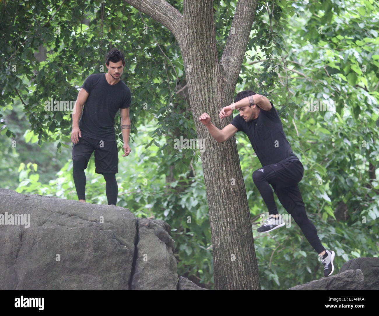 Taylor Lautner wows his fans flying from rock to rock on the film set of 'Tracers'  Featuring: Taylor Lautner Where: Stock Photo