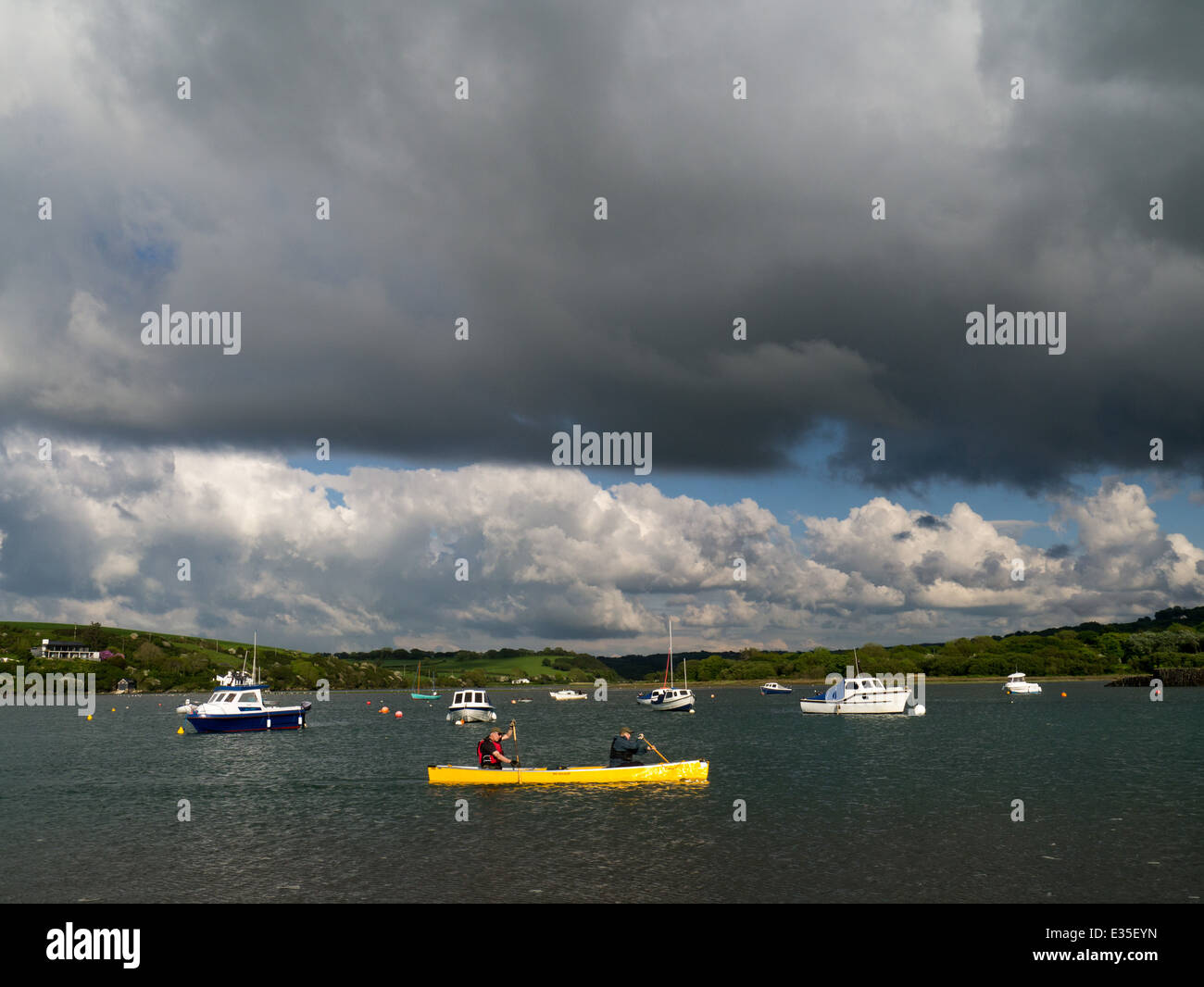 boats, including a yellow canoe, in Newport Bay, Pembrokeshire, Wales - Stock Image