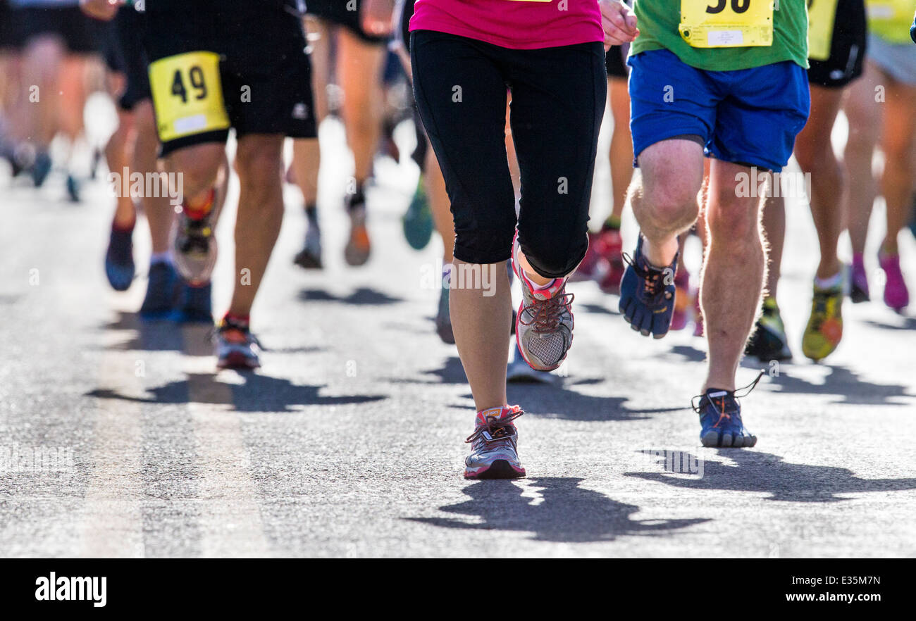 Close-up of runners legs and feet in 5K & 10K foot races, annual FIBark festival, Salida, Colorado, USA - Stock Image