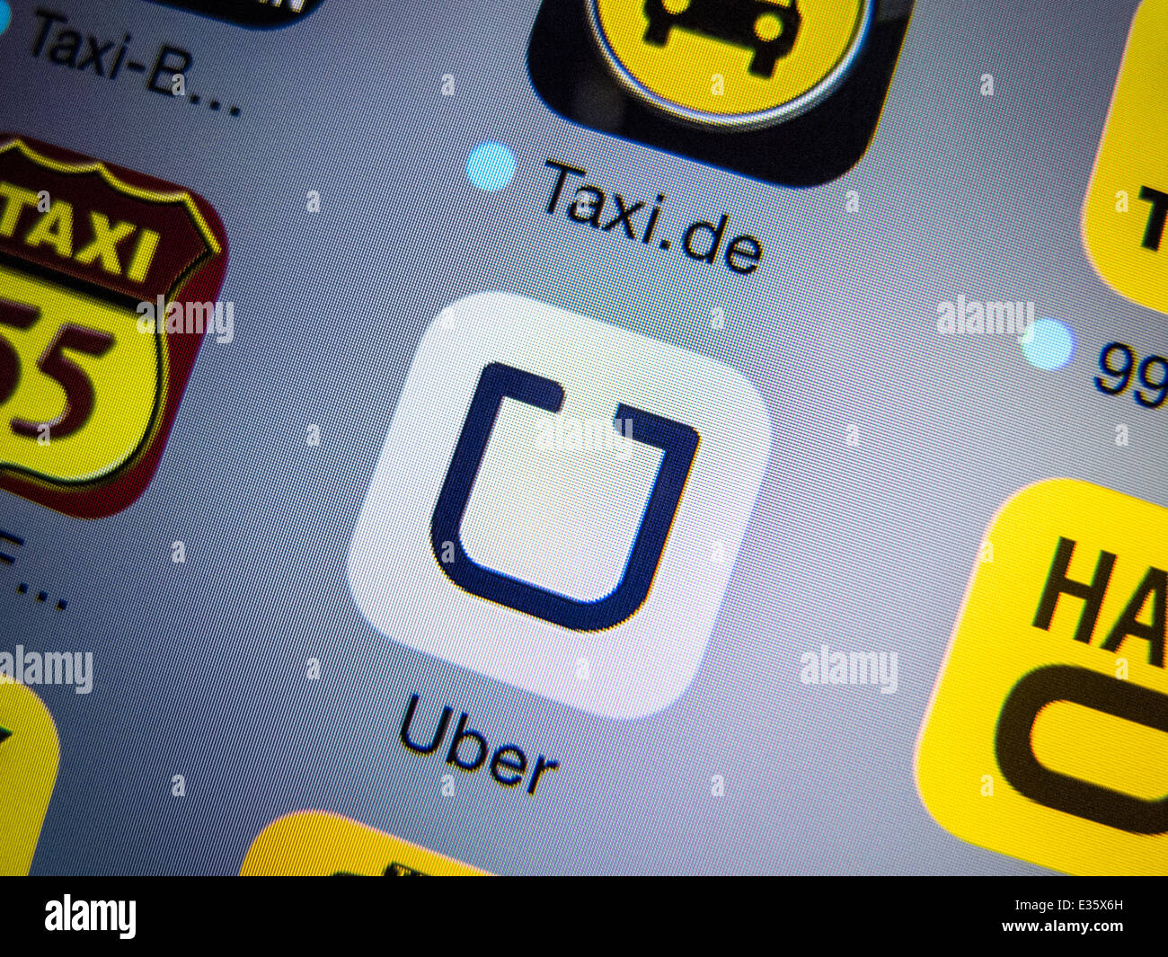 Detail Of Uber App Icon On Iphone For Booking Taxis Stock Photo