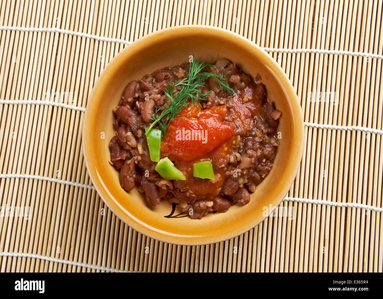 Ful medames - Egyptian,Sudanese dish of cooked and mashed fava beans served with vegetable oil, - Stock Image