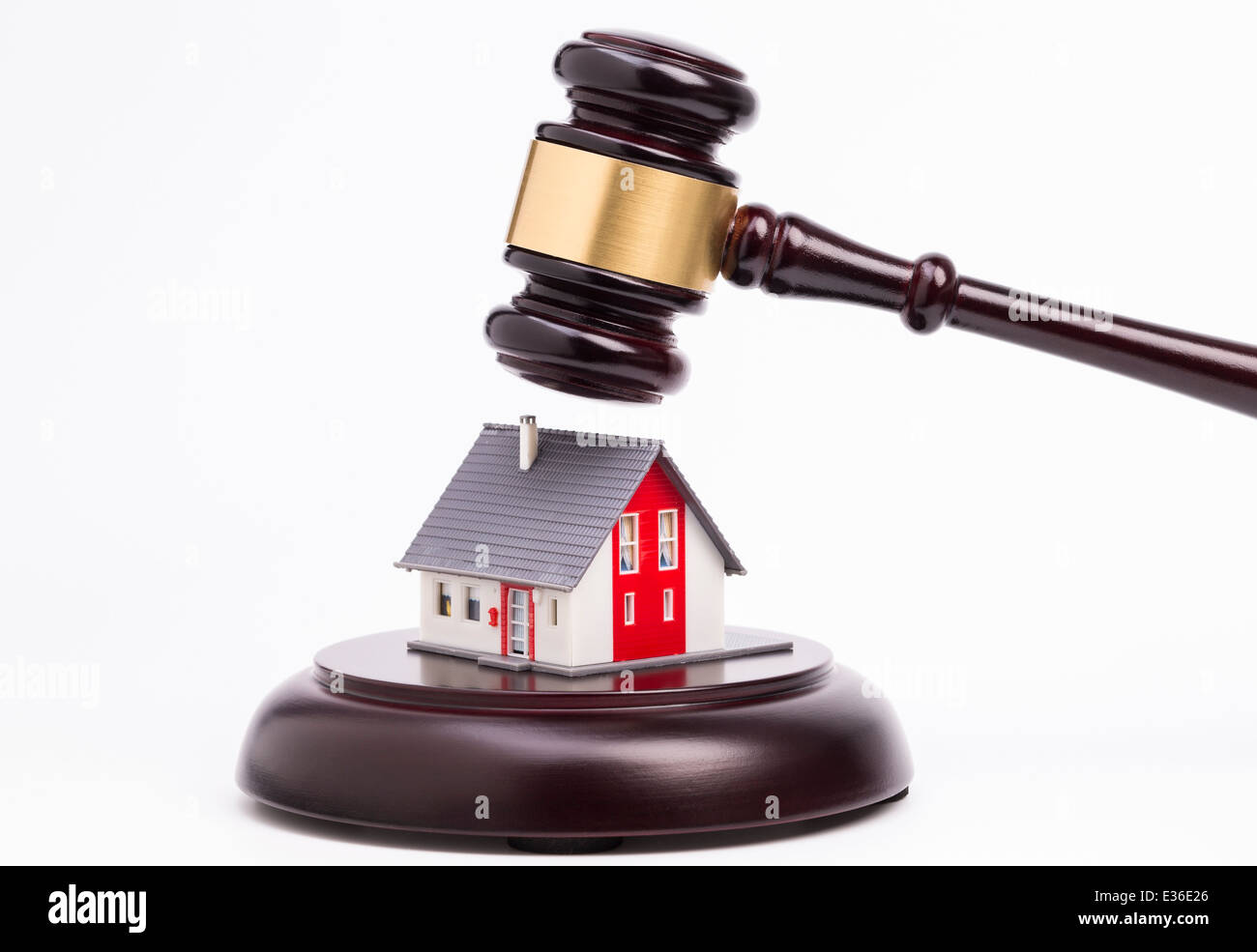 Wooden judge gavel with house isolated on white background Stock Photo