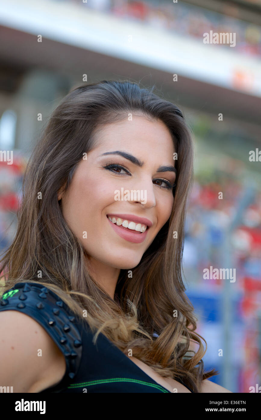 Monster Energy grid girl of the Monster Energy Gran Premi De Catalunya stands in front of the grandstand - Stock Image