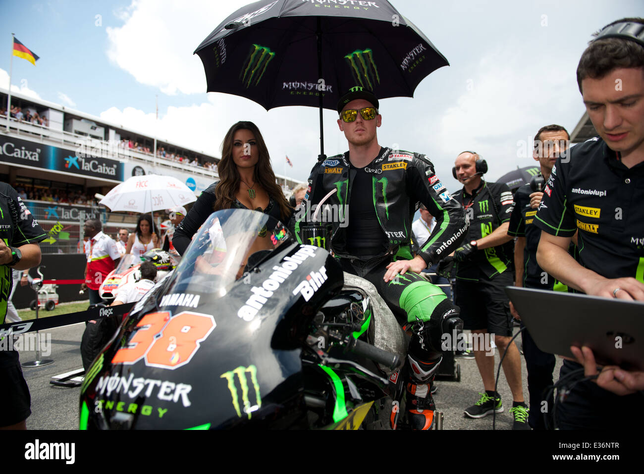 Bradley Smith on the start grid for Round 7 of the 2014 FIM MotoGP World Championship at Circuit De Catalunya. - Stock Image
