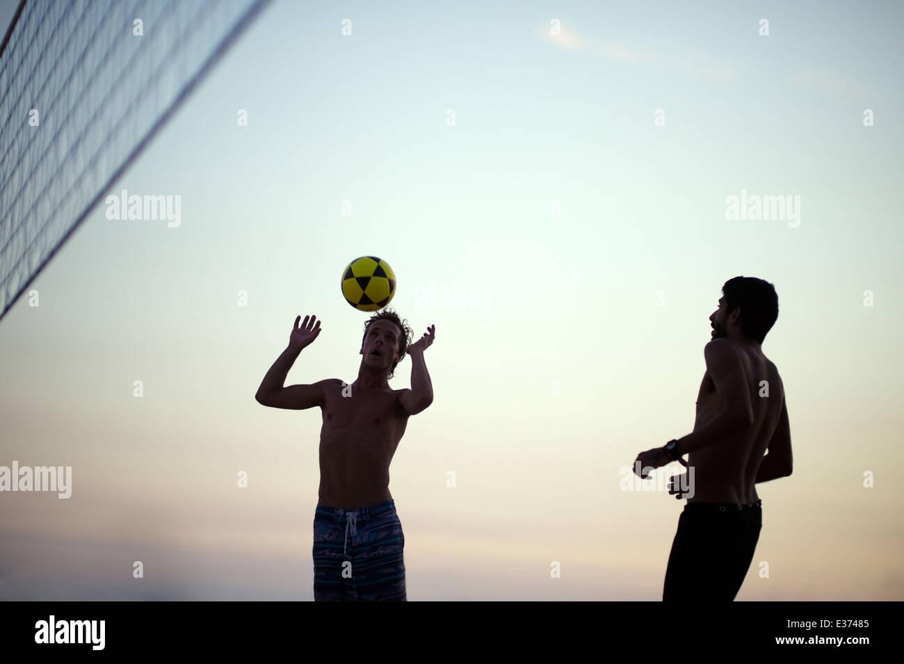 RIO DE JANEIRO, BRAZIL - FEBRUARY 11, 2014: Brazilian men on Ipanema Beach playing footvolley, a football volleyball - Stock Image