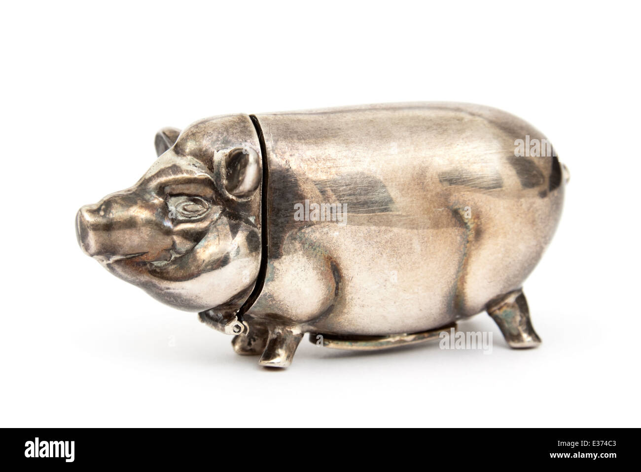 Pre-WW2 Continental Silver Pig Vesta (French or German) for storing matches, with the striker on the pig's belly. - Stock Image