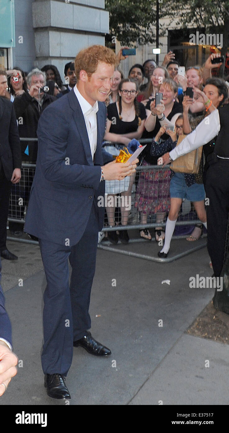 Prince Harry Getty Images Gallery in London and was given a present by a fan for his new nephew Prince George.  - Stock Image