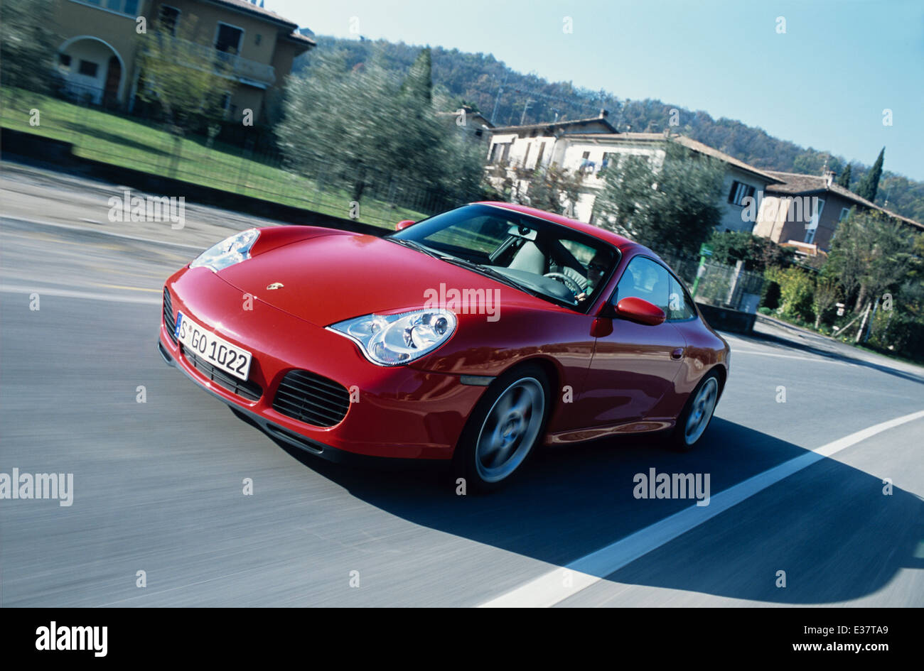 Porsche 911 Carrera 4S - 996 Model - 2001 in red - front three quarter view driving - Stock Image