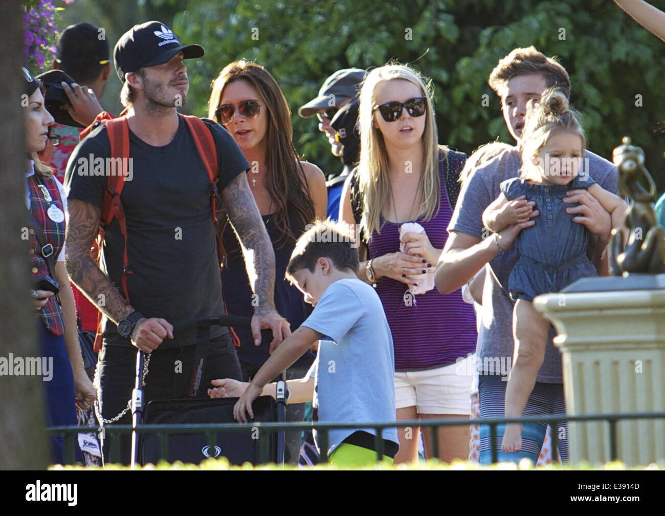 David and Victoria Beckham spend quality time with their kids at Disneyland. The famous family spent lots of time - Stock Image