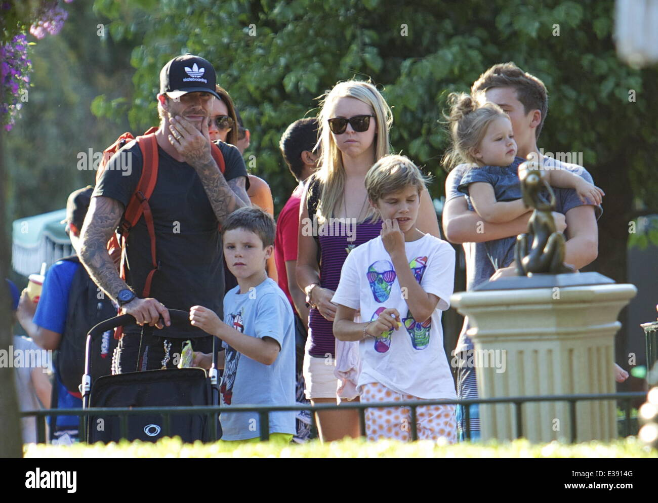 David and Victoria Beckham spend quality time with their kids at Disneyland. The famous family spent lots of time Stock Photo