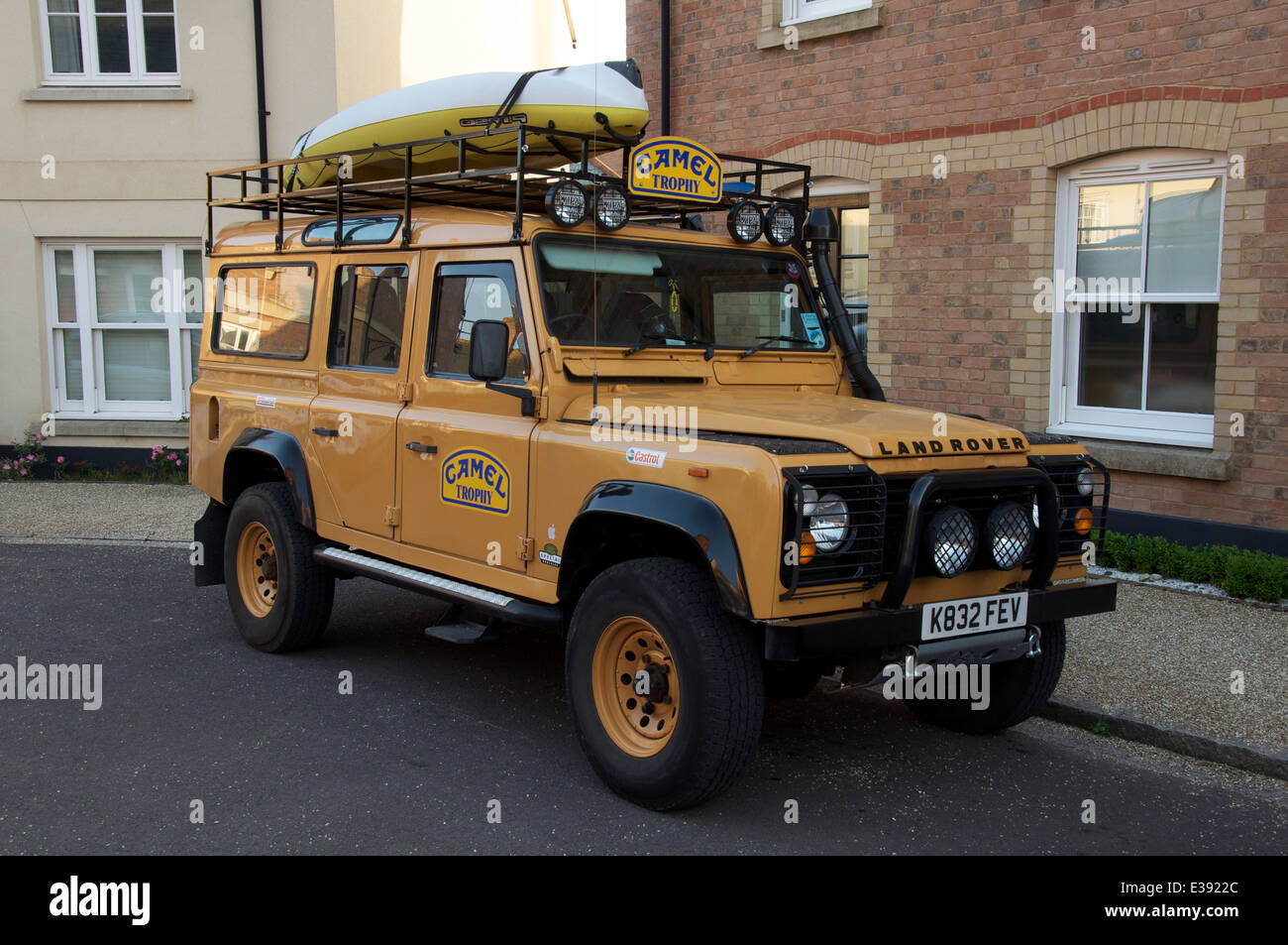 Mymini : Mini Pickup  A-camel-trophy-land-rover-defender-a-rugged-off-road-vehicle-parked-E3922C