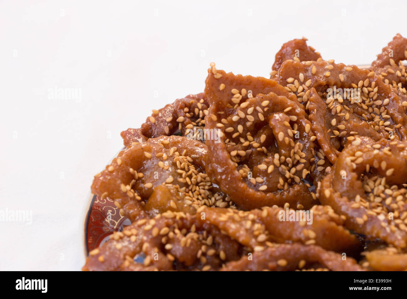 Ramadan Pastries dipped in honey sprinkled with sesame seed - Stock Image