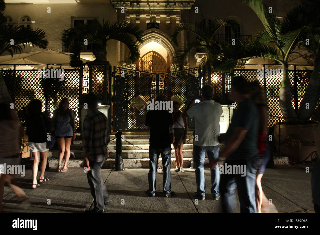 People gather outside the former residence of designer Gianni Versace on South Beach. Stock Photo