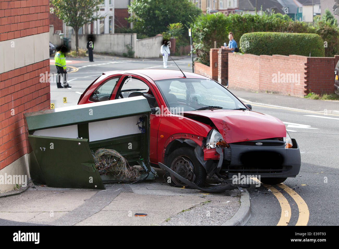 A Red Ford Ka Can Be Seen Crashed Into A Telecoms Cabinet And Three People Are Reportedly In Hospital After A Shooting Incident Near The Crosshands Hotel On