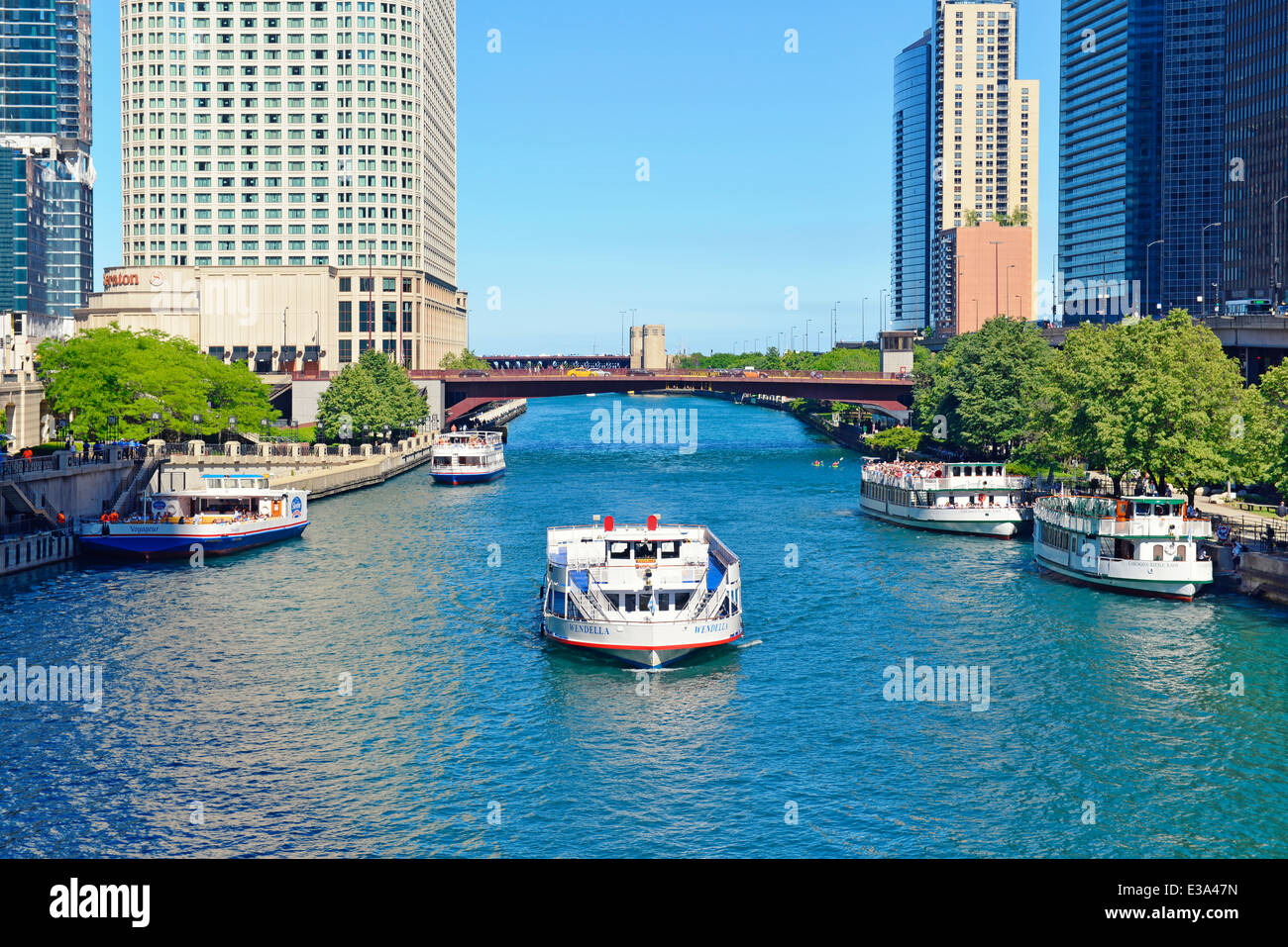 Tourist Cruise Boats on the Chicago River, and moored, lined up along the renowned Riverwalk, Illinois, USA; - Stock Image