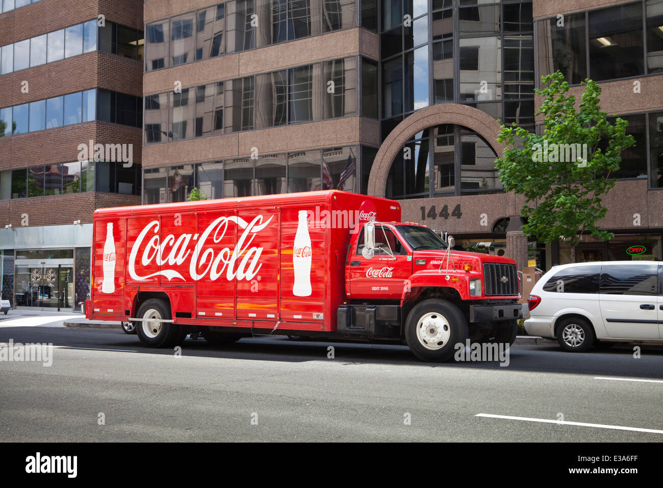 Coca-Cola delivery truck parked outside office building - Washington, DC USA - Stock Image