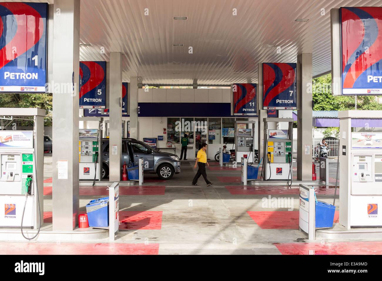 A man walks through a Petron Corporation petrol station in ...