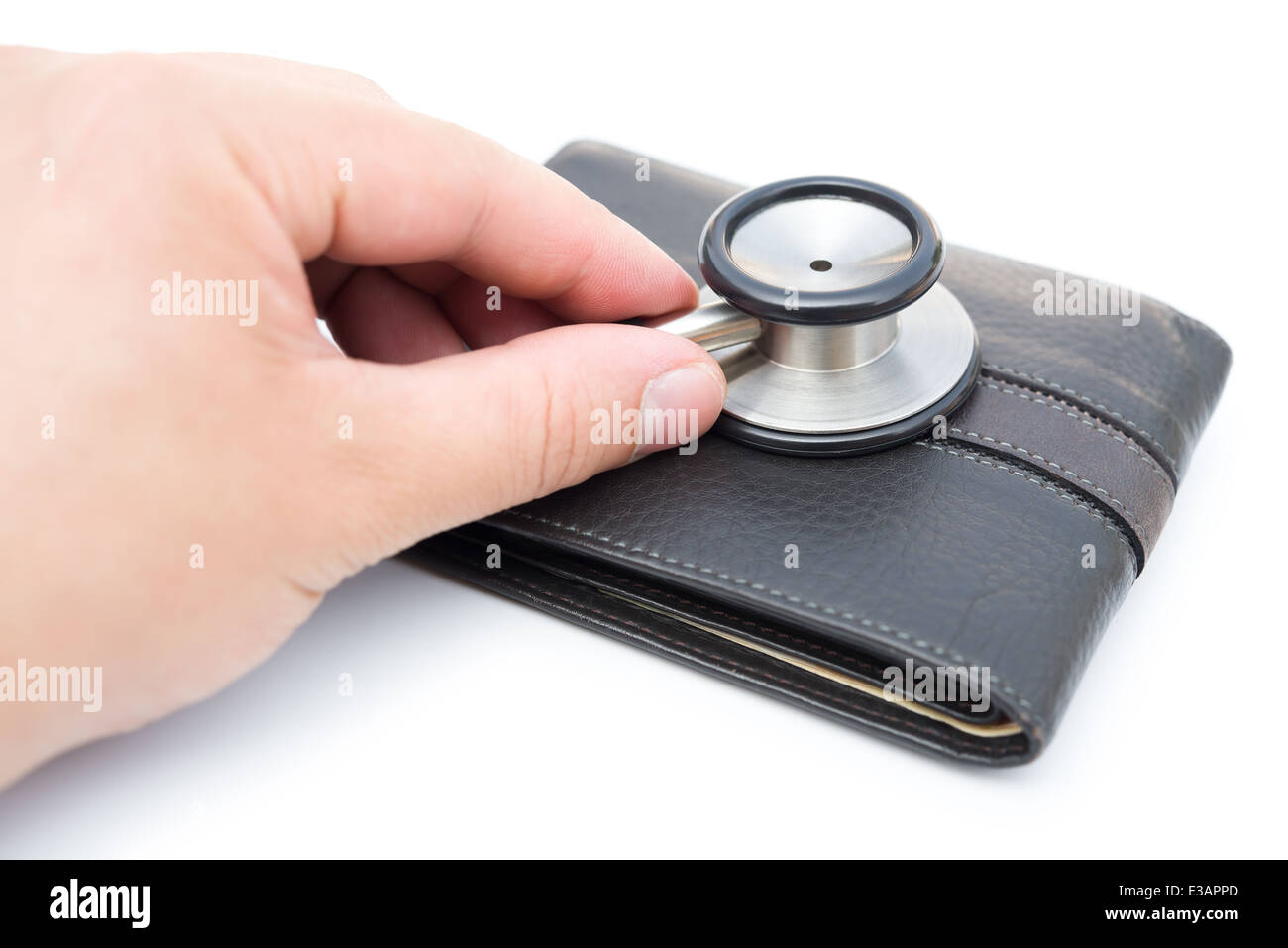 diagnosing a wallet on white background - Stock Image