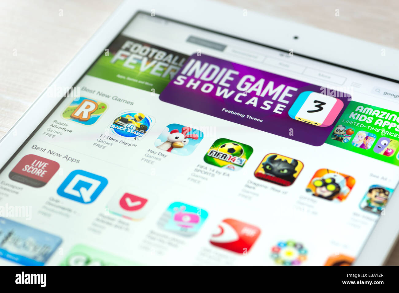 Brand new modern white Apple iPad Air with featured mobile games apps in App Store collection - Stock Image