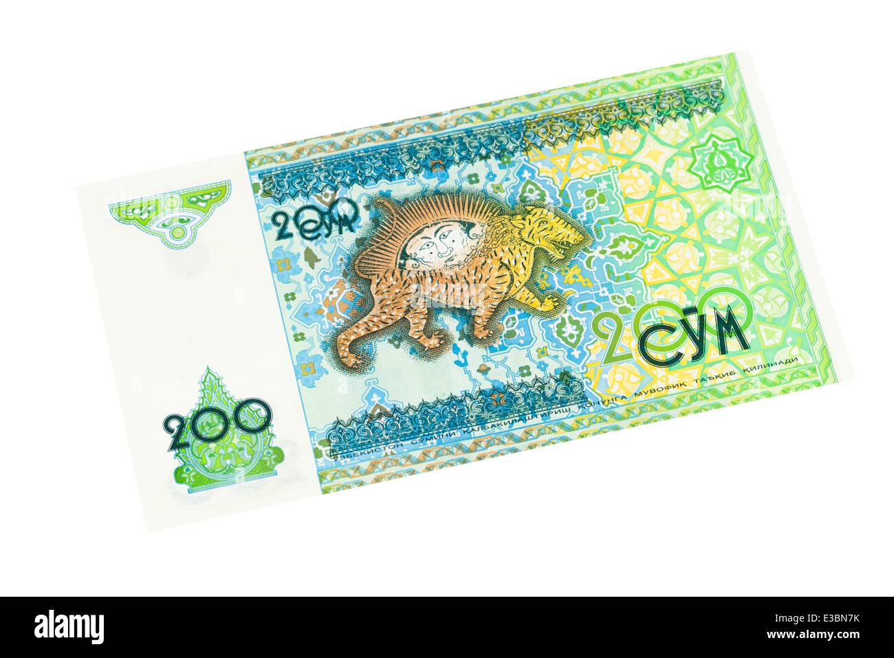 Uzbekistani two hundred som banknote on a white background - Stock Image