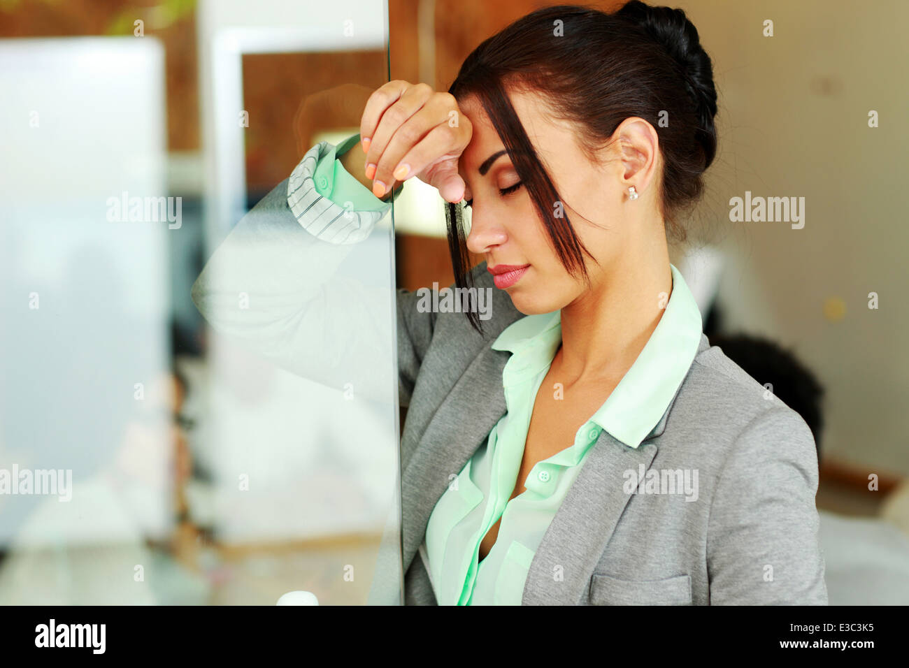 Portrait of a beautiful tired businesswoman - Stock Image