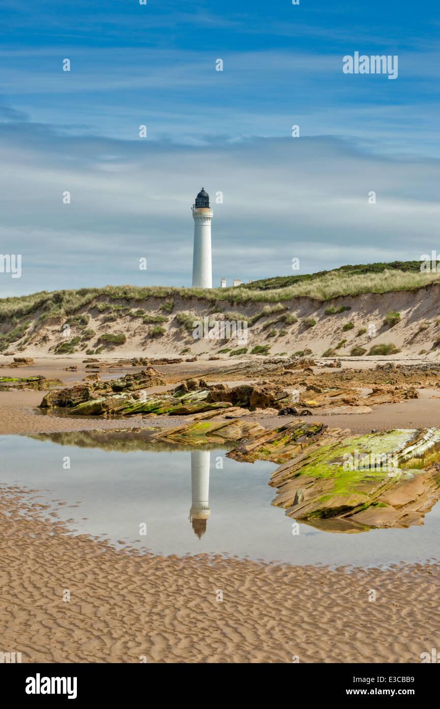 COVESEA LIGHTHOUSE LOSSIEMOUTH AND SEA POOL REFLECTION MORAY COAST SCOTLAND - Stock Image