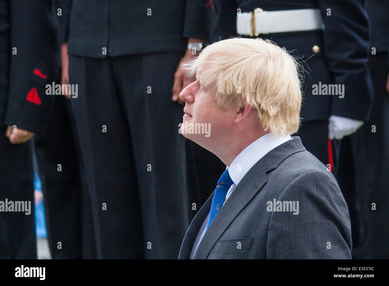 London, UK. 23rd June, 2014. Mayor Boris Lohnson watches the flag being raised at City Hall as members and veterans - Stock Image