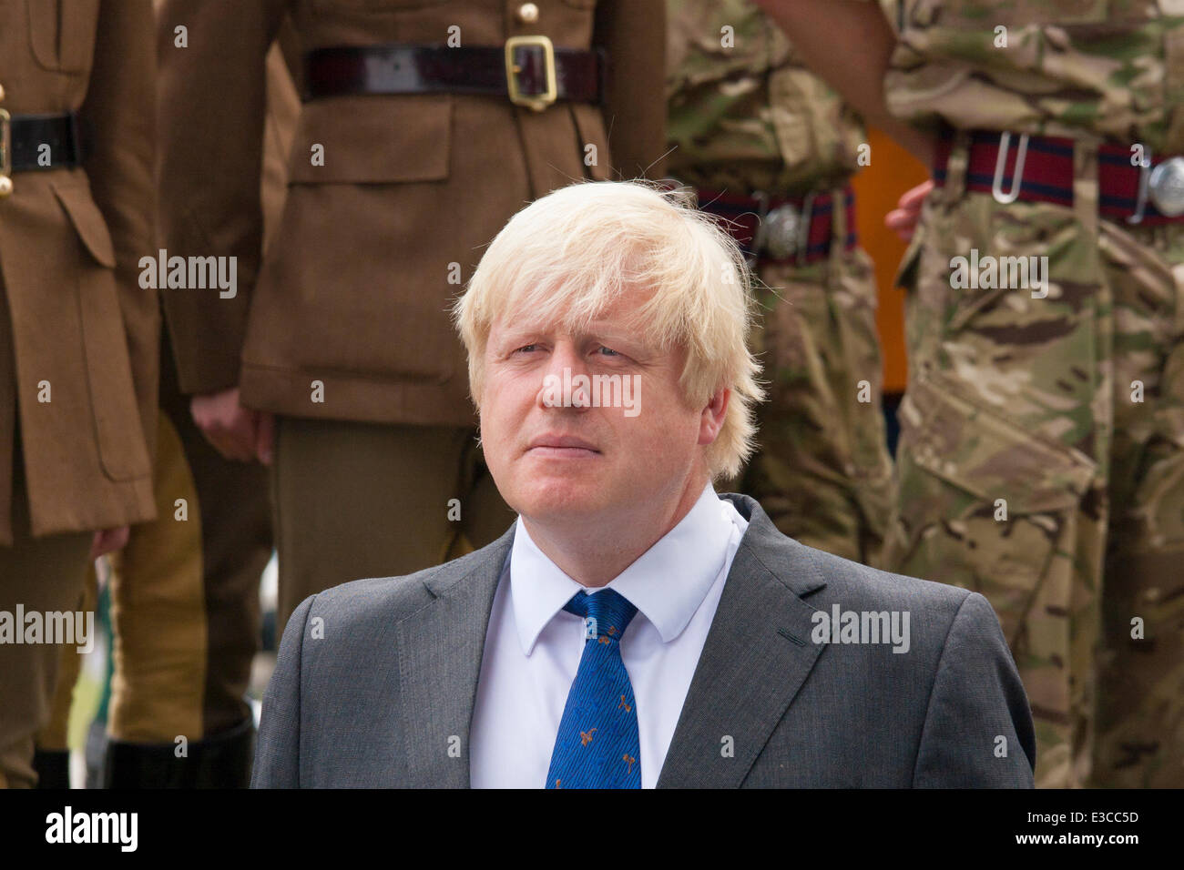 London, UK. 23rd June, 2014. Mayor Boris Johnson listens to speeches as members and veterans of the armed forces - Stock Image