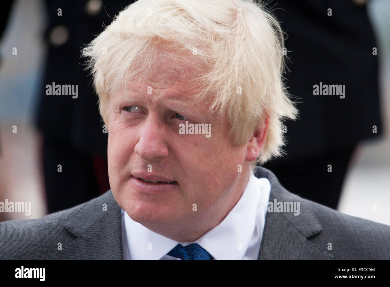 London, UK. 23rd June, 2014. Mayor Boris Johnson listens to speakers as members and veterans of the armed forces - Stock Image