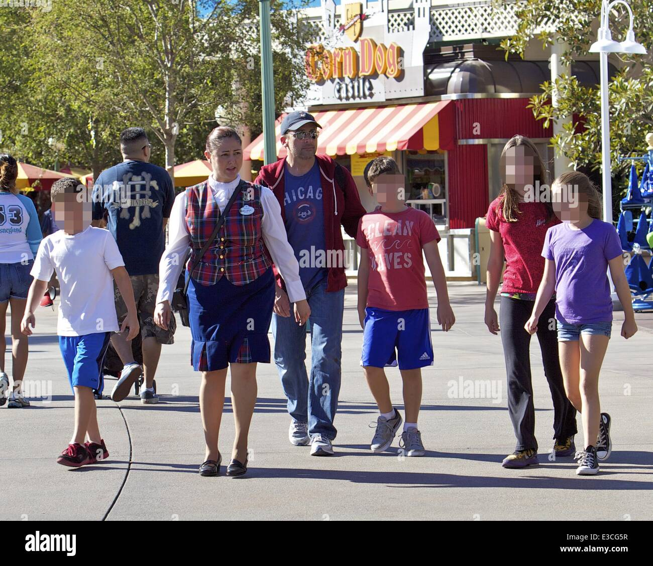 Steve Carell wearing a baseball cap with monogram letter 'F' spends the day at Disneyland in Anaheim with - Stock Image