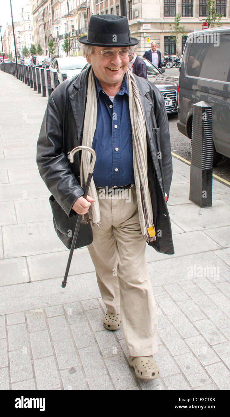 Sylvester McCoy out and about near the BBC Studios in Central London wearing a pork pie hat, Crocs plastic shoes - Stock Image