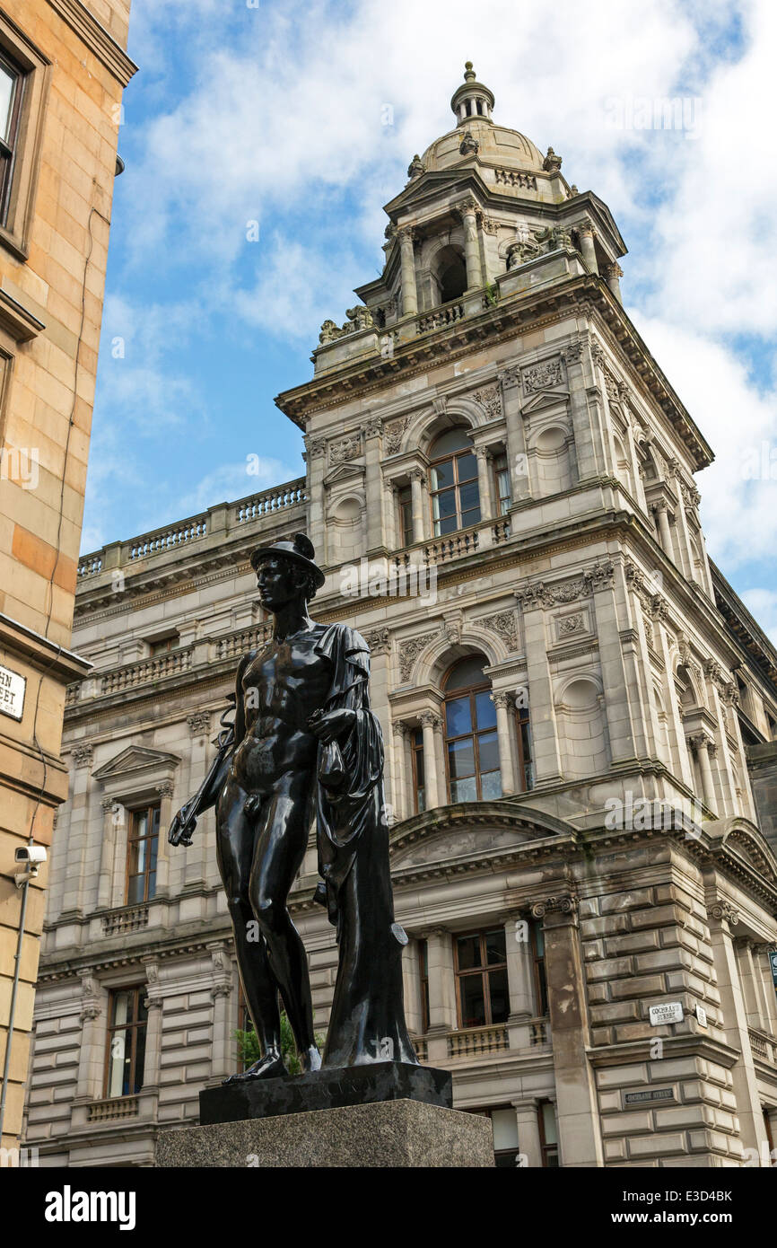 Statue of the Roman god Mercury, Italian Centre, Glasgow the the City Chambers in the background. - Stock Image