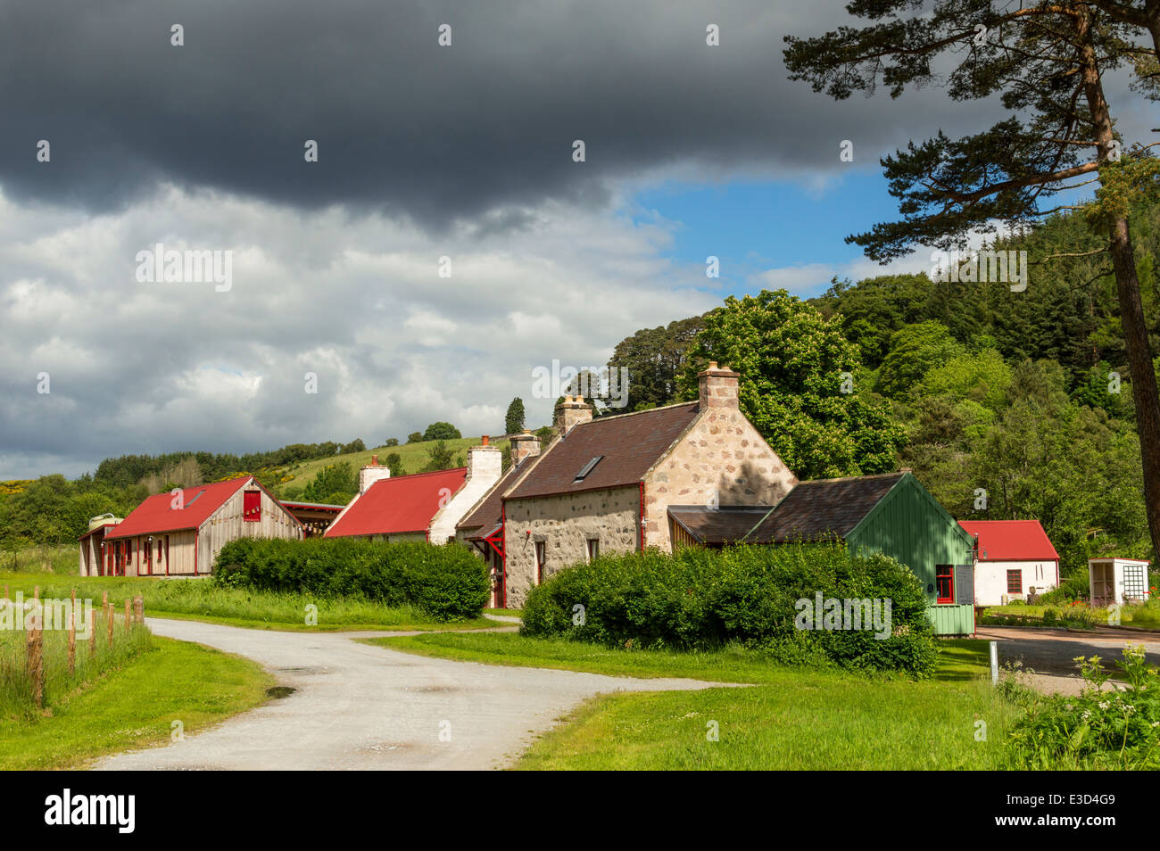 KNOCKANDO WOOL MILL ON SPEYSIDE MORAY SCOTLAND AND STORM CLOUDS IN SUMMER - Stock Image