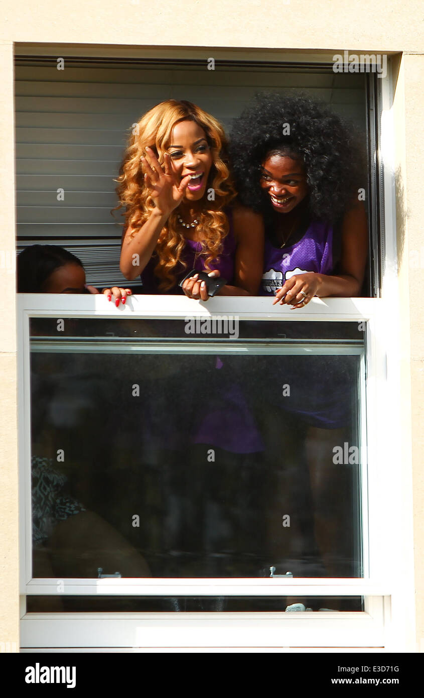 Members of girl band Miss Dynamix wave out of the window of the X Factor finalist's house  Featuring: Miss Dynamix - Stock Image