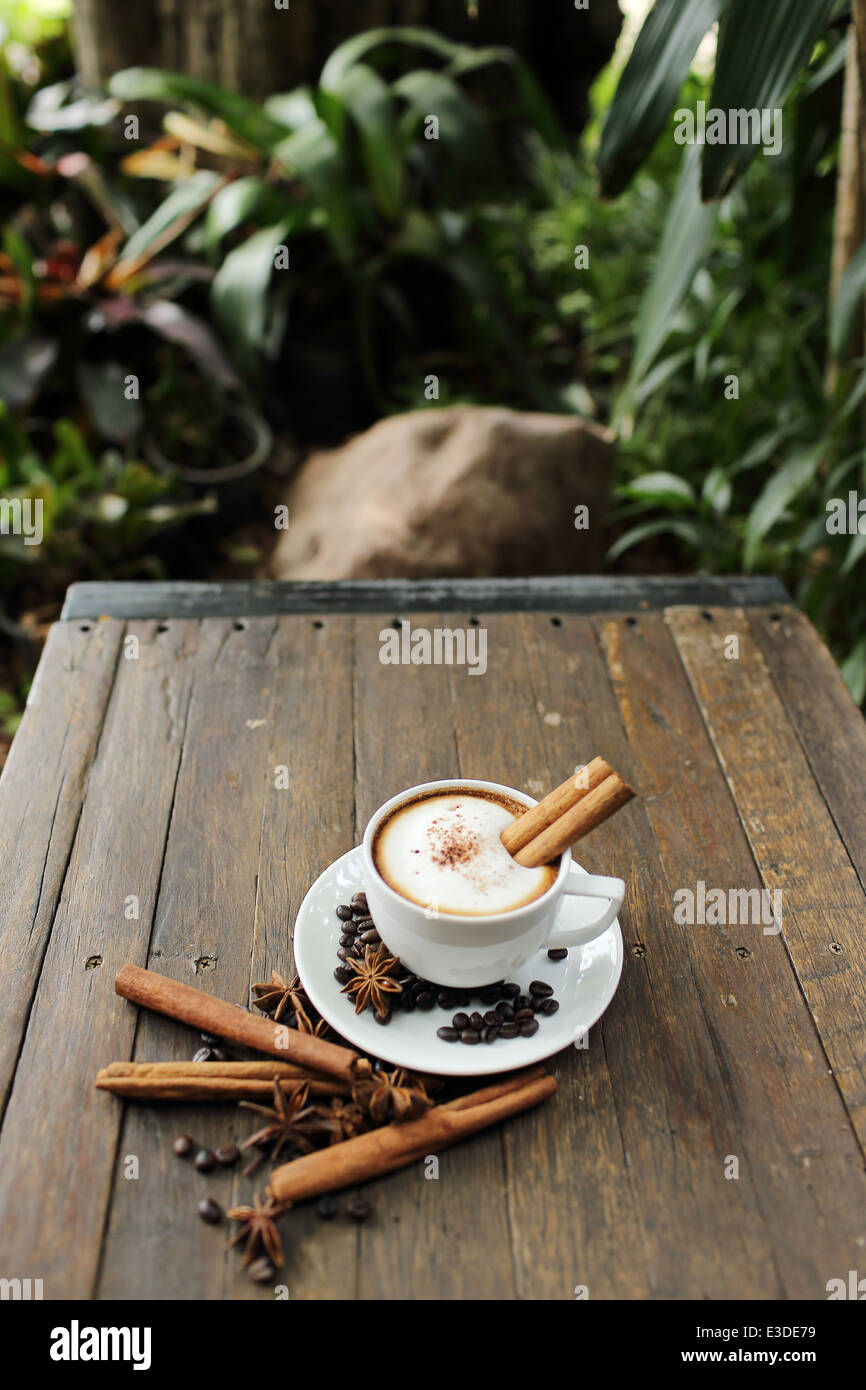 Composition with white cup of coffee - Stock Image