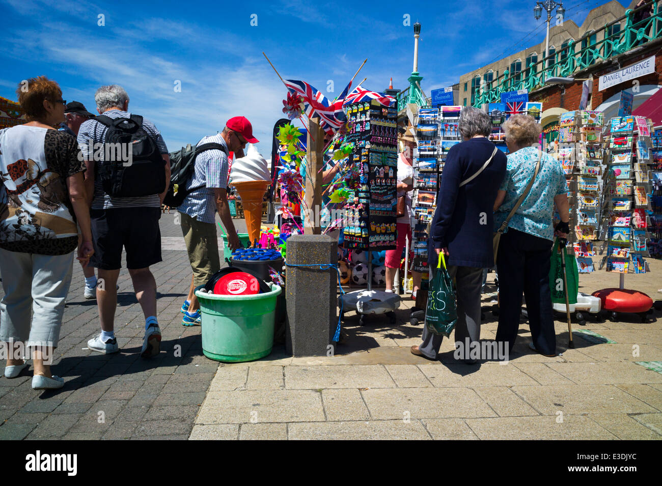 Tourists buying postcards on the Broadwalk at Brighton beach, England, UK - Leica M9 picture - Stock Image